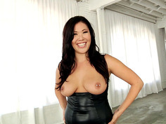 London Keyes wearing black latex outfit showing off her pierced nipples