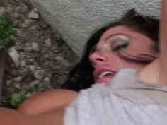 Horny brunette gives blowjob in public.