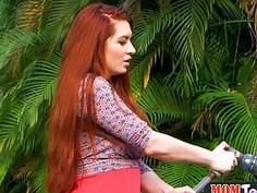 Bossy redhead MILF licks a petite teen pussy outdoor