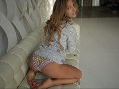 Beautiful Kate posing on a sofa