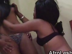 Two amateur ebony lesbian babes rub each other vagina on the bed
