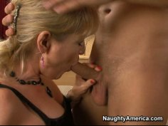 Gorgeous mature woman Tina Tosh sucks young cock and gets her pussy eaten.