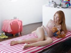 Playful redhead teen Michelle doing herself