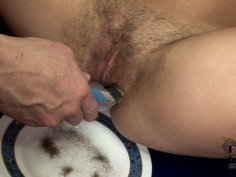 Dirty-minded brunette makes a horny dude to shave her hairy pussy