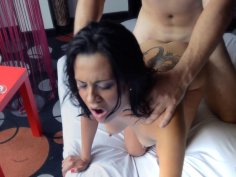 Tattooed brunette rides his shaft balls deep on the bed